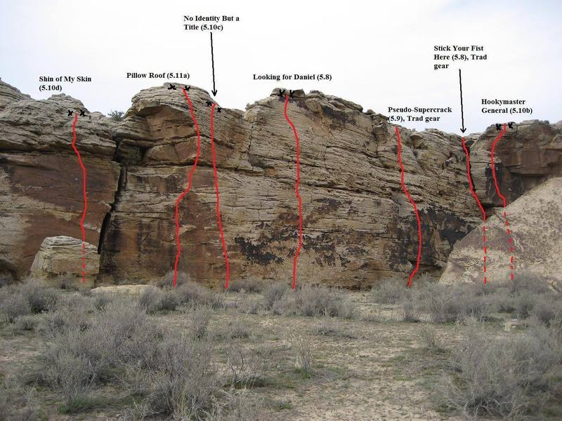 Photo-topo of the Slab Wall, including all known routes.  Bolted anchors are shown; routes w/o anchors indicated DO NOT HAVE anchors.  All anchors can be accessed from the top of the cliff for toproping, but pulling the rope after rapping can be difficult from some of them.