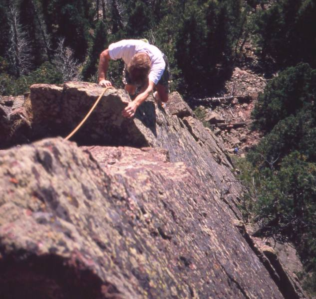 William McGehee close to the top of FA of 'Over The Rainbow (5.10b, S)' in Fern Canyon, in the Flatirons. If run onto the end of Rainbow Bridge, this makes the combined pitched into a nearly 200' 4-star affair, and one of the best in the area. Photo by Tony Bubb.