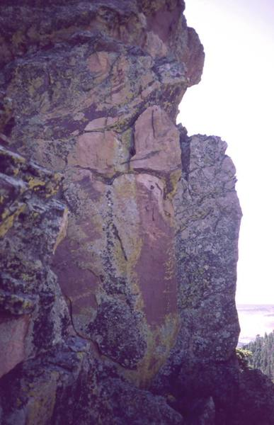 'One In The Chamber' ascends the corner just left of the nearest arete in this photo then continues up the face above.