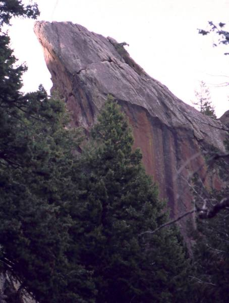 'Stone Love (10d, PG-13)' comes up the SW face of the box on a 5.8 handcrack to reach a ledge, then arcs out and right below the summit, hanging over space in the nearly horizontal crack seen in this image before turning upward toward the summit on the slab to the right. It is a unique line that should be a destination climb in the Flatirons. Photo by Tony Bubb, 2005.