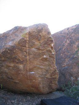 The first problem at the icecapades, desert rally follows and overhanging arete to the topout for a V3