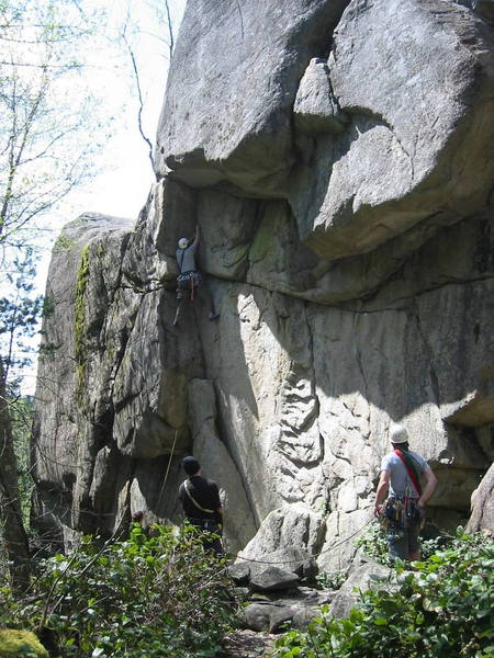 The climber is on Orphan (5.9).  Block and Tackle (5.11b) takes the weakness through the main overhang.