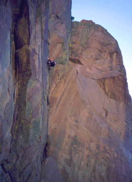 """Sylvia Luebben about to get onto the crux ramp of """"Nameless Demons (10b)"""" on Rock Of Ages, near Estes Park, CO. Photo by Tony Bubb, August 2002."""