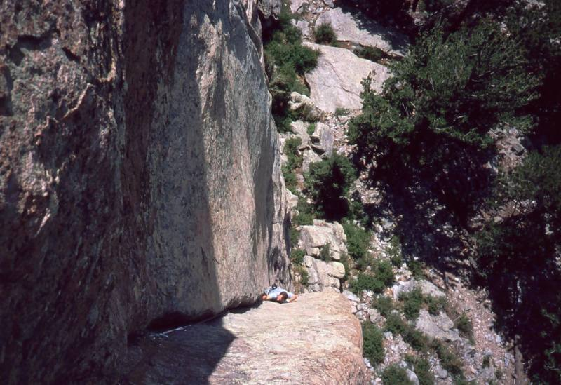 Josh Janes follows up on the insecure 'Bonzo (10b)' on Lumpy's Sundance Buttress. Photo by Tony Bubb, 2004.