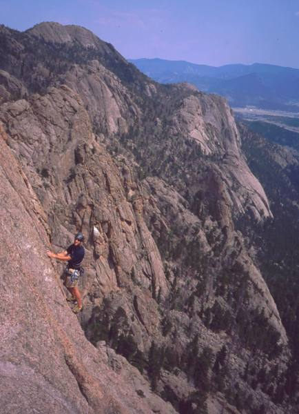An unknown climber on the final pitch of 'The Nose (5.10)' as seen from 'Idiot Wind' on Lumpy's Sundance buttress.  Photo by Tony Bubb, 2002.