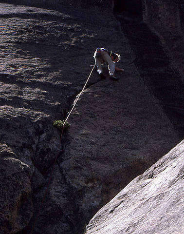 """Al Swanson on the first ascent of """"Psycho Path"""".<br> Photo by Blitzo."""