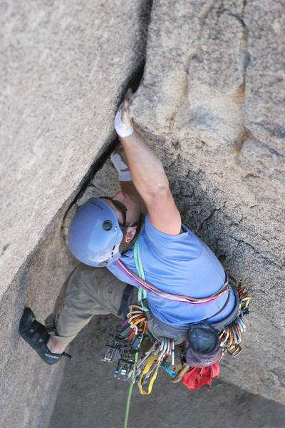 "Jon McCartie mid-crux on Diagnostics.  If the first 15 feet of this route went on for a hundred or so, it would be quite the classic.  Alas, it suffers from the JTree ""if only it were longer"" syndrome."
