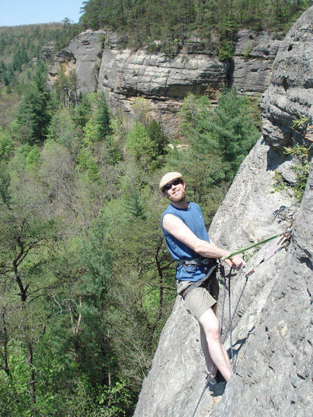 Casey atop one of the routes on the far right wall... roadside attraction is in the background...