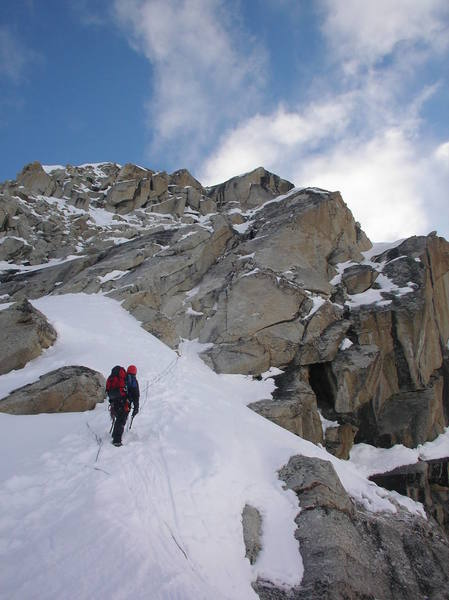 Andy Grauch  midway up the first rock pitch on the southwest ridge of peak 11,300, while Ty Cook simul-climbs.