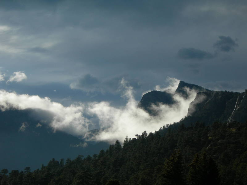 Sundance Buttress and Sundance Needle covered by a shroud of rare low clouds.
