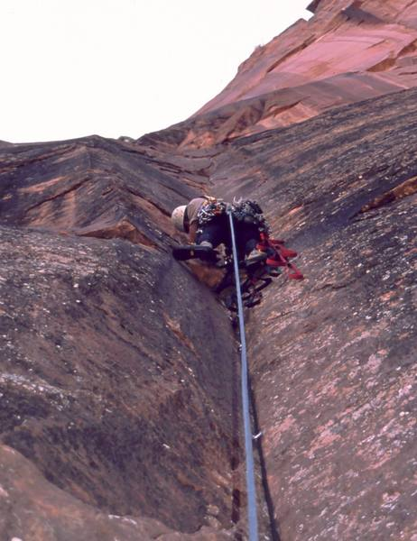 Tony Bubb leads on the upper pitches of Prodical Son (IV, C2) in Zion National Park. Photo by Mary Ann Dornfeld, 2004.
