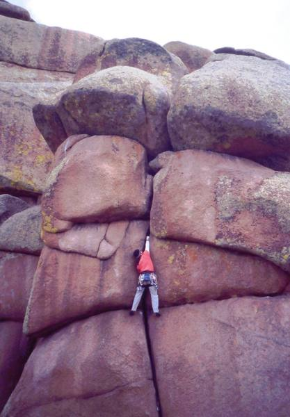 An unknown climber 'Overloads (5.9)' at Vedauwoo.<br> <br> Photo by Tony Bubb, Y2K.
