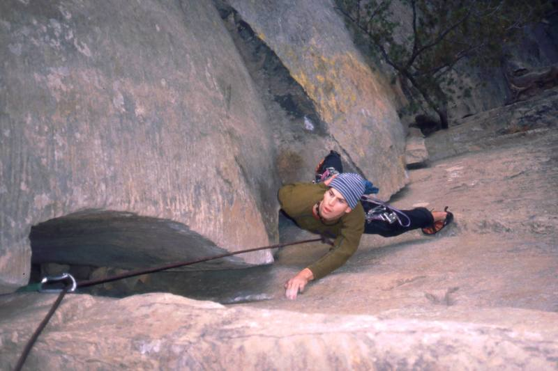 An unknown climber follows Roadside Attraction (5.7+) in Red River Gorge. Photo by Tony Bubb, Y2K.