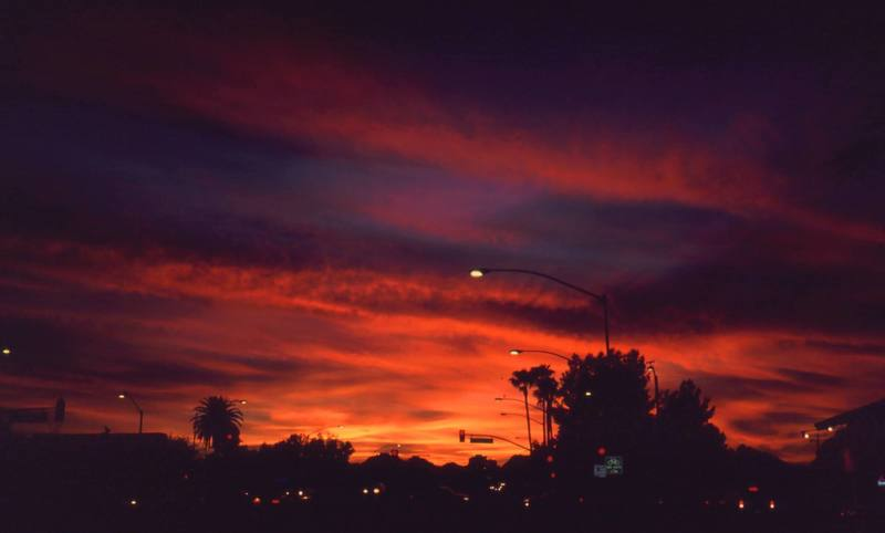 If you are climbing at Mt Lemon, you will probably be saying in Tucson. This will be your evening view, even from downtown.<br> Sunset on Grant Street. Photo by Tony Bubb, 12/24/01.