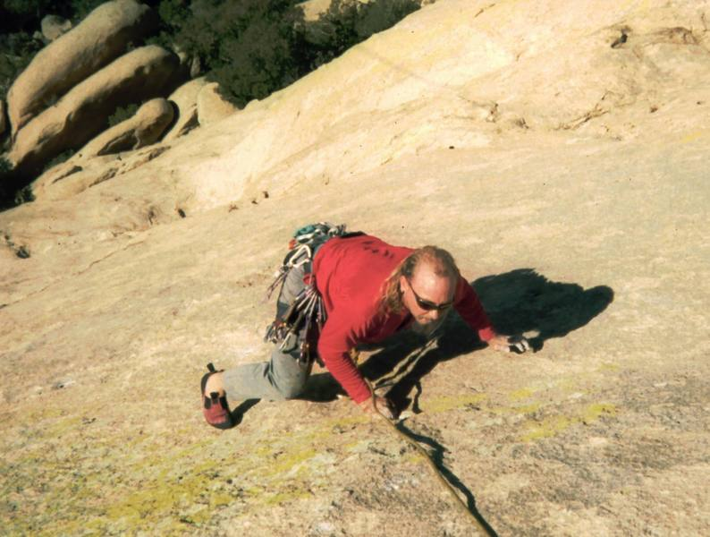 Ron Roach searches for somehting resembling a hold on the lower pitches of 'Warpaint.' Photo by Tony Bubb 12/25/2001.