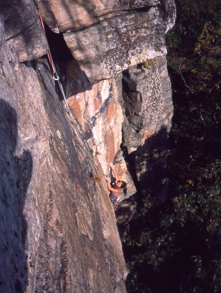 Michelle Moffat emerges from the second crux of Matinee' (10d) at the gunks. Photo by Tony Bubb, 10/03.