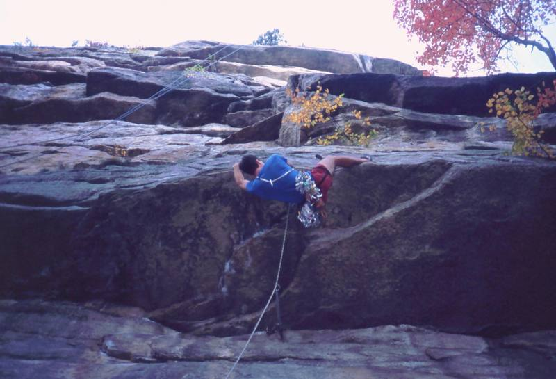 Tony Bubb hears the punch-line on 'Laughing Man' (11b, PG-13). A was told this was 5.10a... Photo by Michelle Moffat, 10/03.