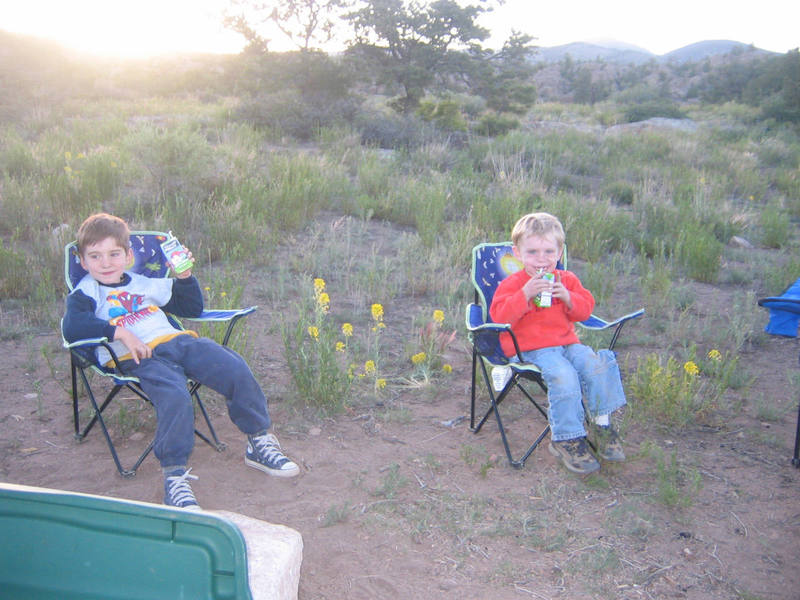 Cody and Miles chillin out, drinking some nice cold apple juice after a long day's climbing in Penitente Canyon, CO. June 2007.