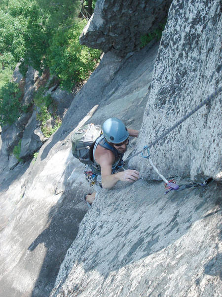 My dad cleans the first piece in the super exposed crux....
