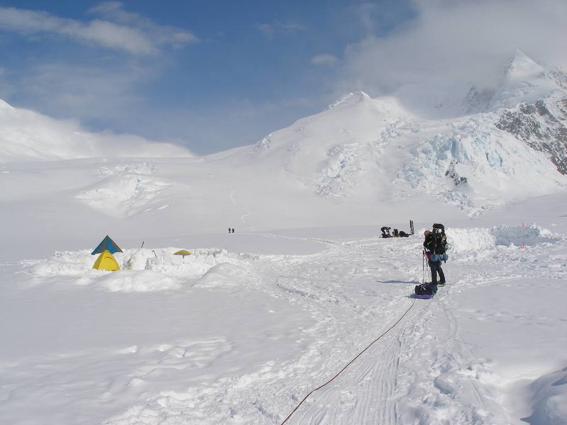 Advanced Base Camp, 6,800 feet.  Stop gawking at Denali and look to your left.  That's Ski Hill ... your introduction to the pain and glory of carrying all of that junk you brought with you up a steep hill.  Beyond, opportunities for exposed camps in whiteout conditions at roughly 9,000 and 10,000 feet.