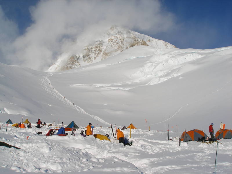 Motorcycle Hill, above the 11,300 foot camp.  The smoking pile in the background is the west end of the West Buttress.
