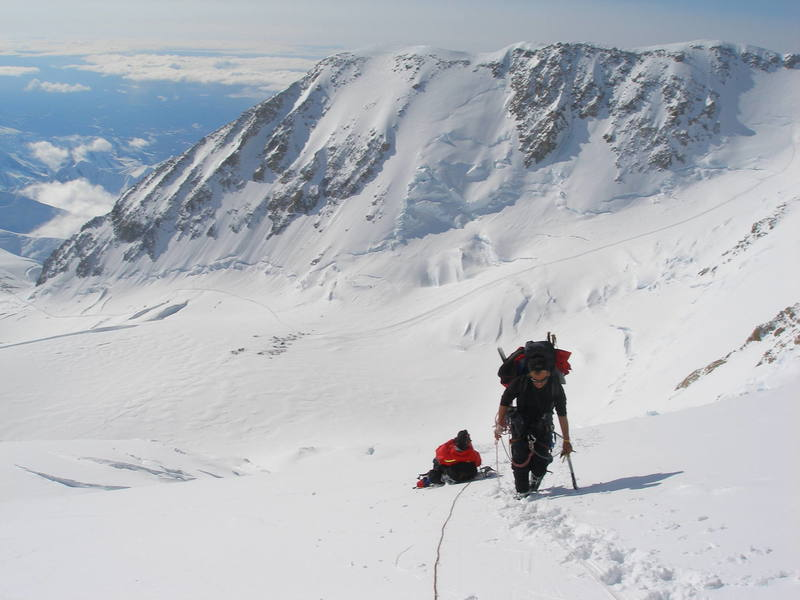 A view from the West Rib cutoff of the West Buttress boot track, from Windy Corner (left) to the camp at 14,000 feet (center), to the fixed lines below 16,000 feet (right).