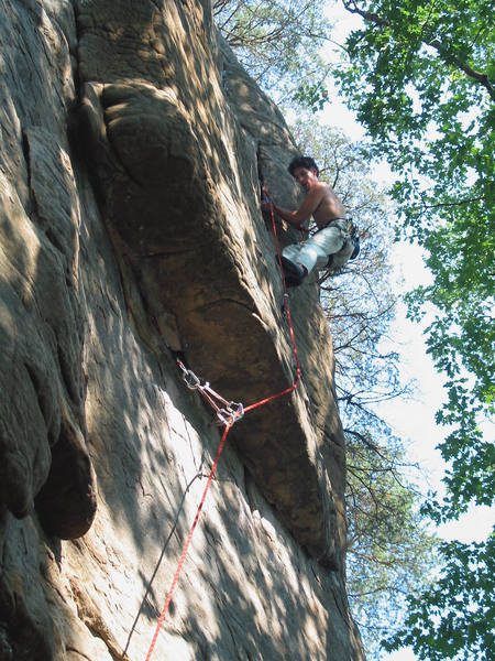 Tracy Brandt leading above the roof crux. August, 2003.