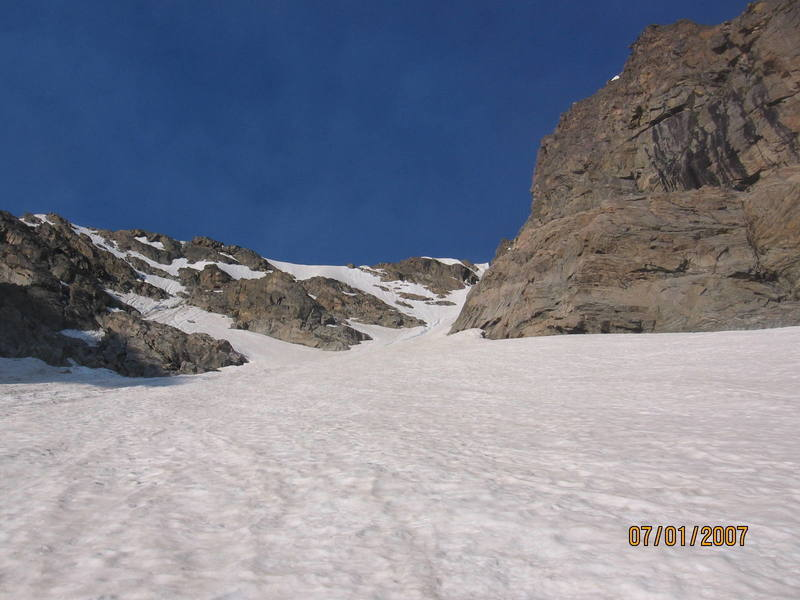 Near the base of the main couloir, when the slope increases dramatically.