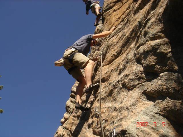 Adam climbing near the third bolt.