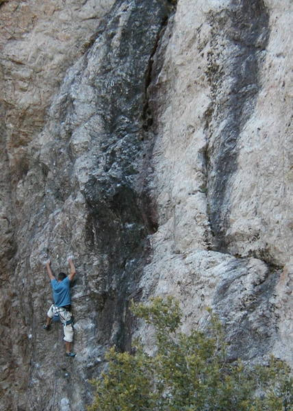 A climber nears the anchors on Industrial Disease (5.10c), Williamson Rock <br>