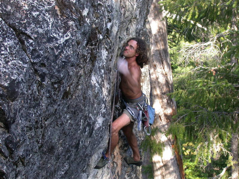 Marc punching for the flash on Humbilly (5.11a), Snag Crag, Land of the Lost