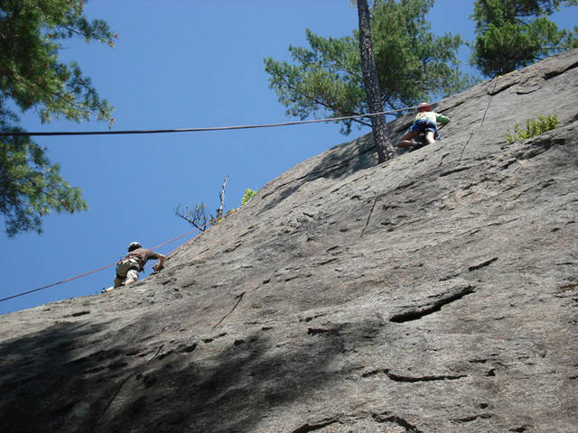 Climbers on the left and right slabs...