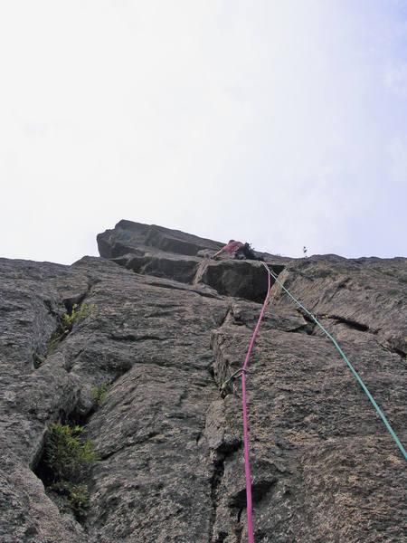 Pitch 3. Climbing up towards the traverse.