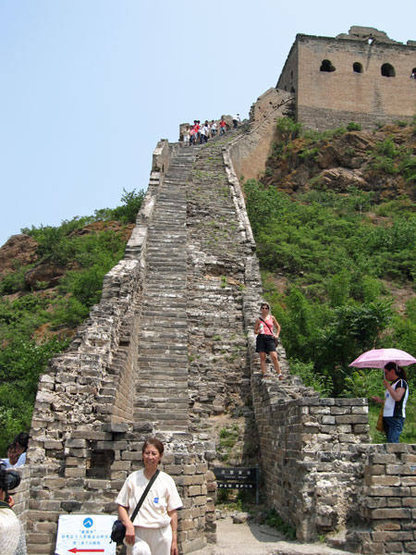 In this area, most tourists are Chinese. They follow the arrow in the lower left and exit the Wall here. Not able to read Chinese arrows, my friends and I headed up the 80-degree stairs and into the adventures ahead.