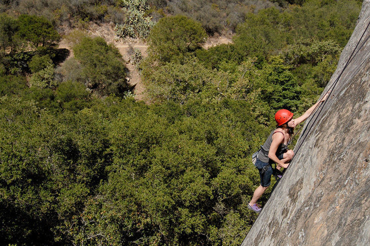 Marissa climbs through Fine Line's 2nd crux, delicate slabby moves past the routes first bolt.