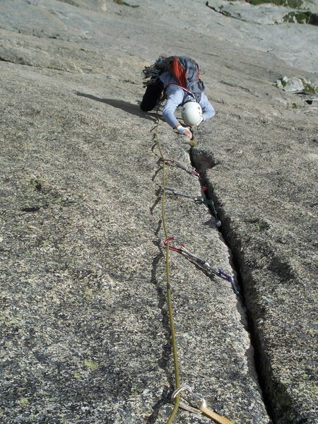 Dean getting into the thin section on the crux pitch of the Barb.