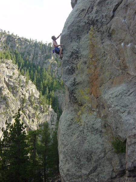 Jeremy George finishing up the first pitch crux on Global Gorilla.