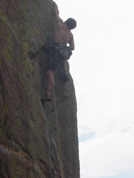 Shaun Reed making the long reach on the lower crux.