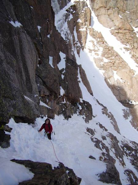 Katie crossing the Ramp in winter conditions (October).  There's a 300-ft drop to her left; a rope is a good idea.