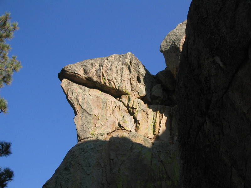 Lizard's Head on the North West corner of Motherload Rock.  Whiptail (5.9) climbs the north (back side in this pic) side and the final move ends with an arm lock in the lizard's mouth to clip the anchors.