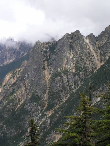 Petit du Cheval is the formation on the left and 5.8 route named Spontaneity Ridge follows the right edge of the formation just left of the rock slide gully (8/04).
