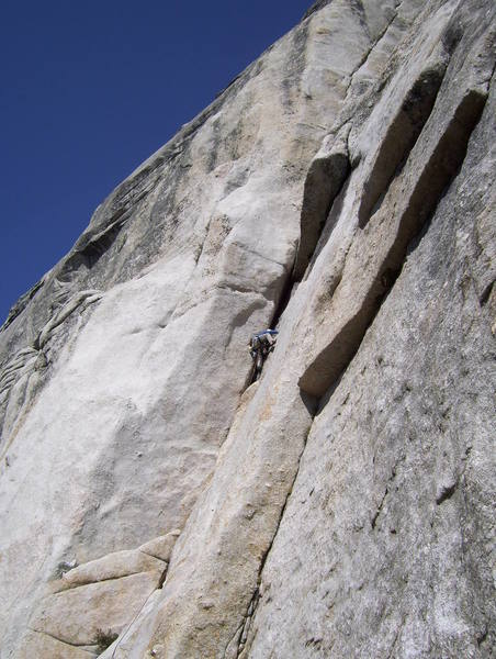 Brian leading p1 of Piss Easy.  Crux bulge just above his head.