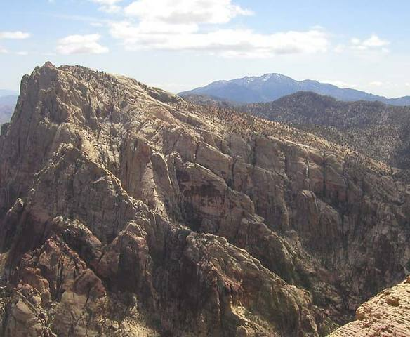 An overview of the area.  Mount Wilson is the big peak.  Cactus Flower Tower, its west ridge delineated by a thin line of sunlight, is the smaller peak in the foreground.  In between is the sweep of ridges and buttresses of Oak Creek's South Fork.