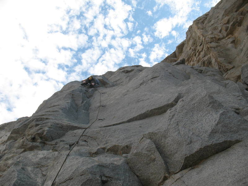 Midway through the crux of Groove Factor (5.10a), Riverside Quarry. The first bolt of Pleasure Dome can be seen to the right.