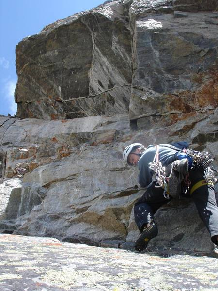 """Starting the """"jug slab"""" traverse. Easy climbing, but careful of that lichen!"""
