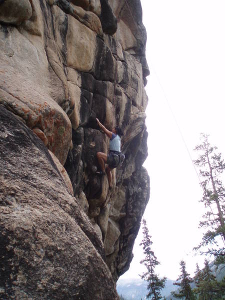 Linda Chang contemplating the crux section