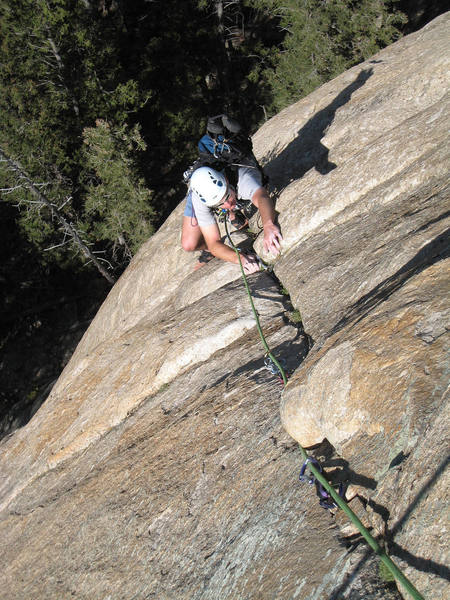 """Working the crack above the 5.11 crux on the first pitch of """"Question of Balance"""". August 2007."""