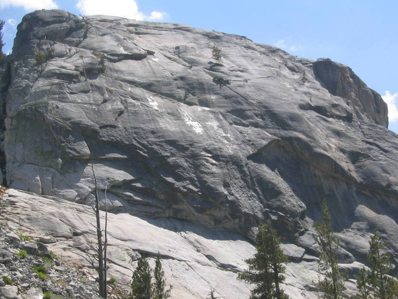 North side of Pywiak Dome.  Climbers on Aqua Knobby crack (the left running 45 degree crack above the roof w/out the shrubbery)