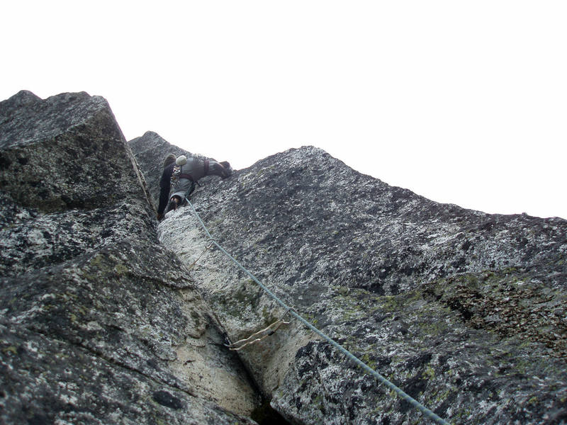 """Crux pitch of """"Superkancie"""" (Super Edge) on the northeast face of Mnich."""