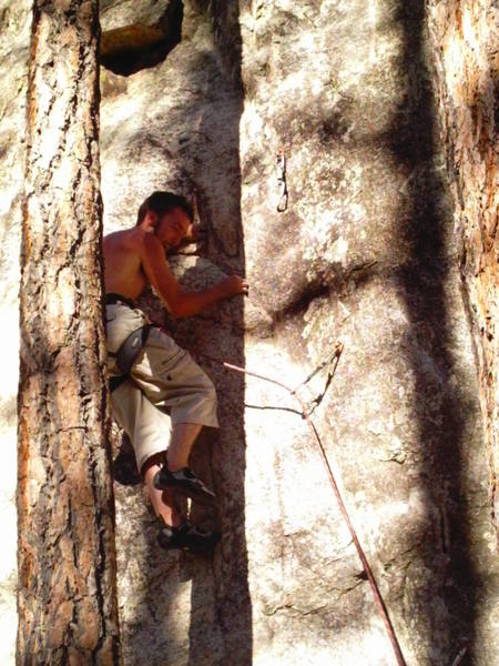 The tree on behind my back has been cut down so it is a pretty easy way to find this route. To the left is a great 5.12a The Wiz.